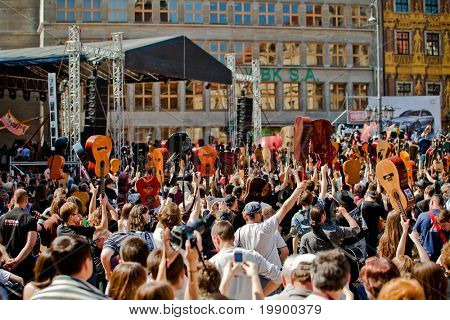 WROCLAW - MAY 1: A crowd of people plays guitars in a Wroclaw marketplace at the