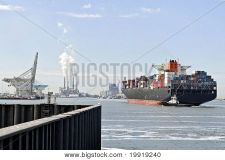 Big containership in Rotterdam harbor