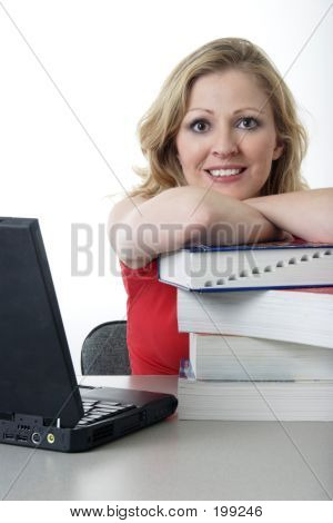 Happy College Girl Leaning On Textbooks