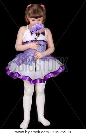 Little Girl In Tutu Smelling Flower. Isolated