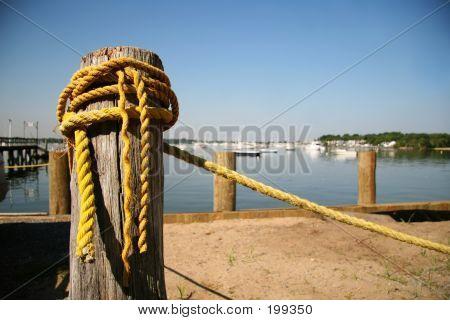 Old Yellow Rope At Marina