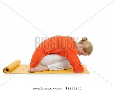 Beautiful fitness woman doing pilates and stretching exercises