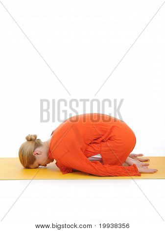 Series Or Yoga Photos. Young Woman Relaxing In Pranama Pose On Yellow Pilated Mat