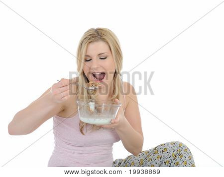 Pretty Woman Having Muesli Cereals For Breakfast. Isolated On White