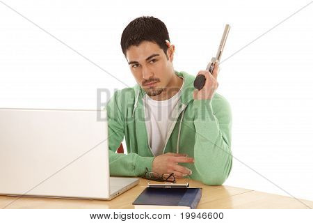 Man In Green With Computer And Gun