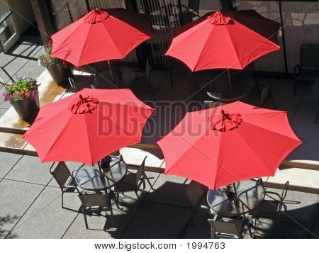 Four Red Umbrellas On A Patio