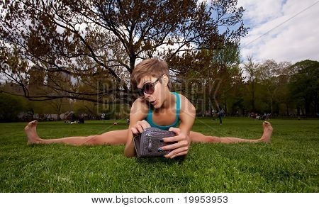 Young Pretty Woman Wearing Sunglasses And Stretching While Looking In Her Wallet.