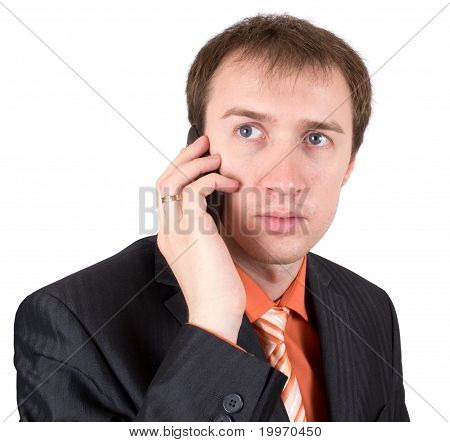 The businessman speaks by a mobile phone