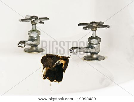 Chromed Faucets on a Broken Sink