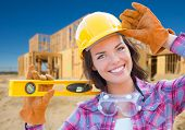 Female Construction Worker Holding Level Wearing Gloves, Hard Hat and Protective Goggles at Construc poster