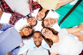 Low Angle Portrait Of Six International Students With Beaming Smiles, Posing For Shot, Outside Schoo poster
