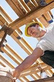Construction Worker Under Formwork Girders poster
