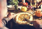 Cutting Pumpkin Pie Dessert Thanksgiving Concept poster