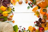 Frame From Vivid Colorful Autumn Leaves, Natural Seasonal Background On White Wooden Background, Top poster