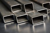 Rectangular metal pipes . Steel materials, construction supplies. poster