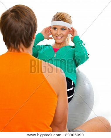 Personal Sport Trainer Helping Healthy Girl Making Abdominal Cru