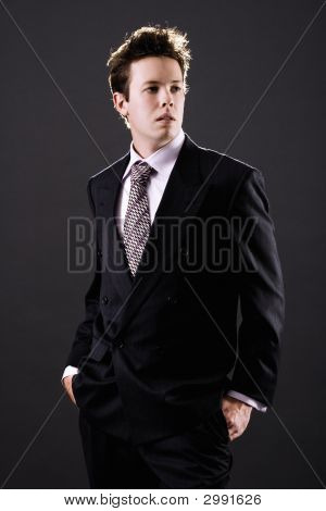 Young Businessman In Suit Thinking