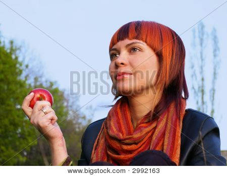 Young Girl And Red Apple