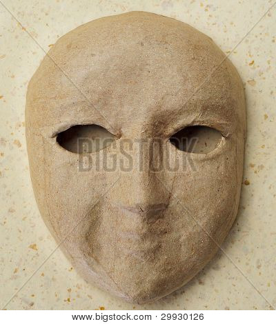 closeup of a simple paper-mache mask
