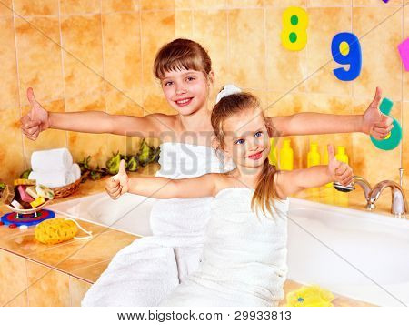 Child washing in bubble bath .