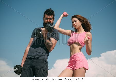 poster of Fit And Strong. Sensual Fit Woman And Bearded Man Doing Sport Exercises. Athletic Woman And Strong H