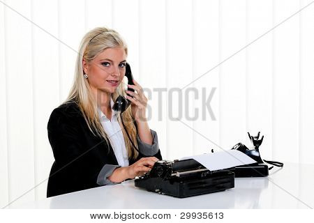 young woman with a telephone in the office.