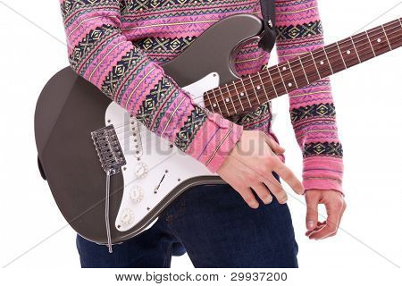 closeup of a rock and roll guitarist on white background. young casual man playing an electric guitar