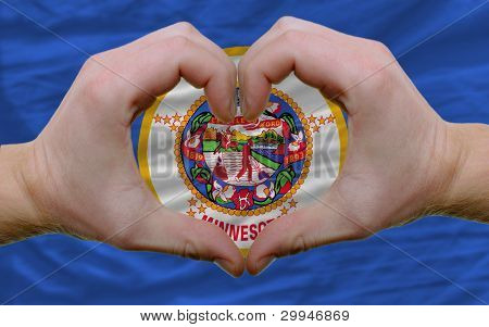 Over American State Flag Of Minnesota Showed Heart And Love Gesture Made By Hands