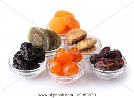 Dried fruits in bowls isolated on white
