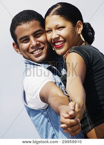 Young couple posing in tango position