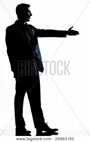 one caucasian man handshake profile  full length silhouette in studio isolated white background