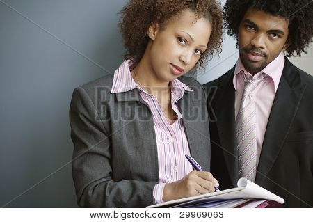 Business people signing paperwork