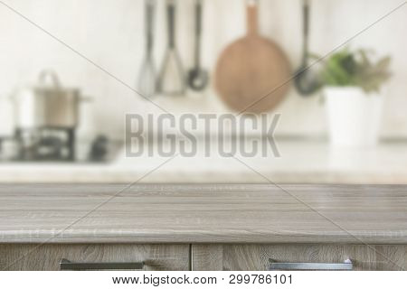 poster of Blurred Abstract Background. Modern Kitchen With Wooden Tabletop, Space For You And Display Products