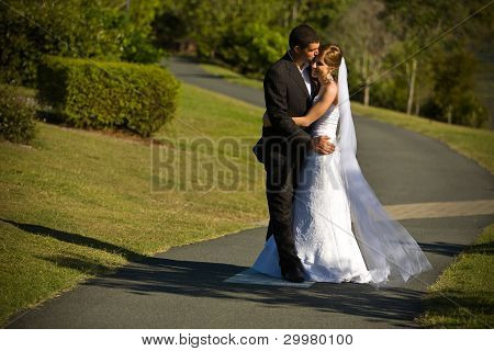 Newlyweds Embracing On A Winding Path