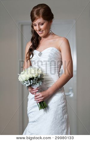 Bride Holding Bouquet And Looking Down