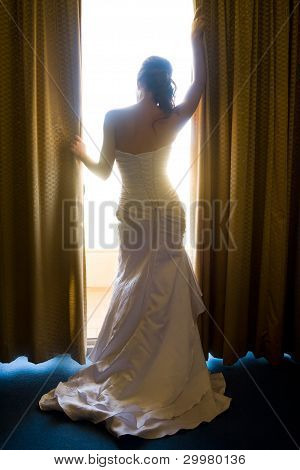 Bride From Behind Looking Through Curtains