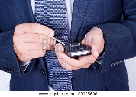 businessman with mobile phone in hand