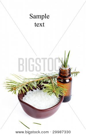 Sea salt with aromatic oil and fir branch on white background(With sample text)