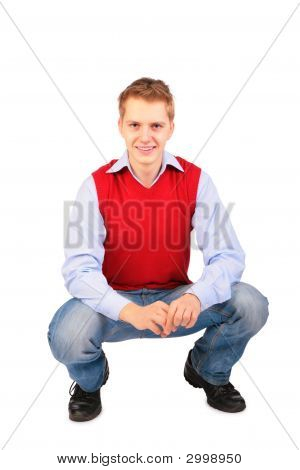 Boy In Red Jacket Sits