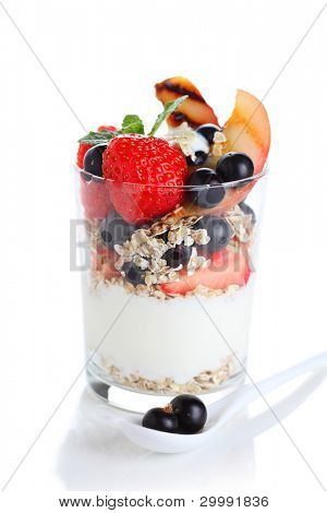 muesli with yogurt and fresh berries on a white isolated background