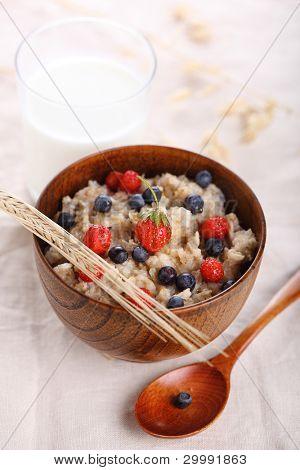 oat porridge with fresh berries. Healthy eating.