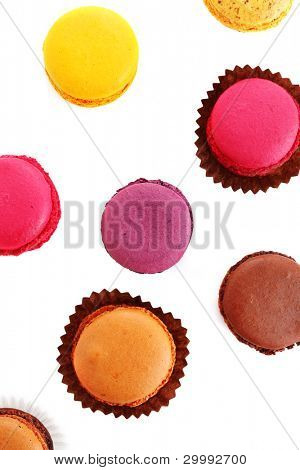traditional french macaroons in isolation of a white background -top view