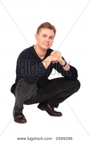 Young Man Sits On One'S Hunkers