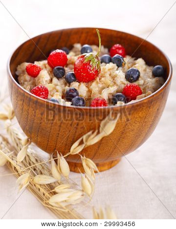 Bowl of oatmeal porridge. Healthy eating.