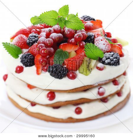 Cake with fresh fruits isolated on white background, soft focus