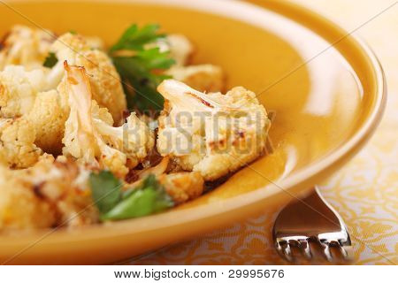 Roasted cauliflower with lemon peel and garlic