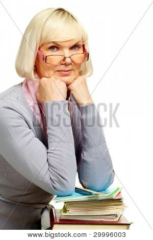 Elderly teacher isolated on white background looking at camera