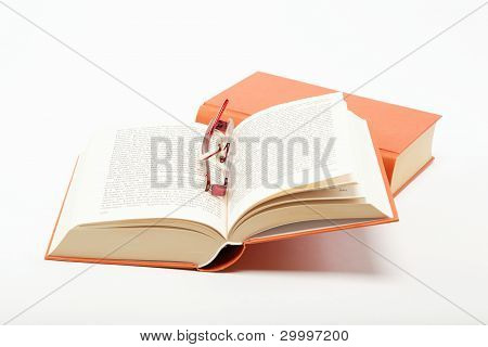 Opened Book With A Glasses