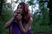 Young Beautiful Attractive Woman In Purple Skirt In The Forest With A Hallucinogens Mushroom At Myst poster