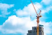 Construction Site With Crane And Building. Real Estate Industry. Crane Use Reel Lift Up Equipment In poster